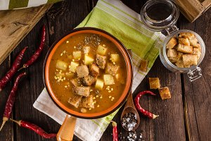 Goulash soup with croutons and potatoes