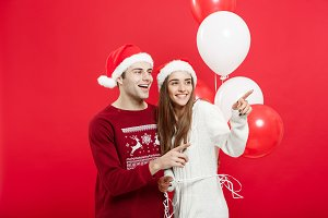 Christmas concept - Portrait of a romantic young couple with chr