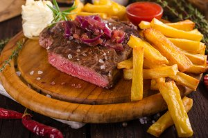Beef steak with homemade french fries, beer and tartar sauce