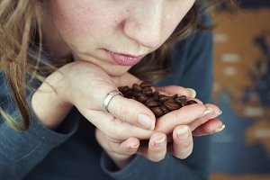 Coffee beans in a woman hand