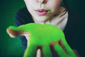 Young woman painted with green