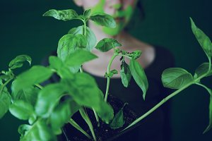 Young woman and a green plant