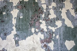 Concrete wall with old paint.