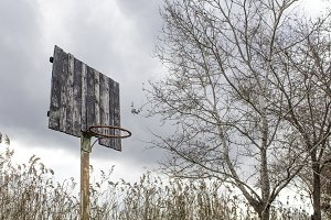 Old basketball backboard and basket.