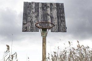 Old basketball backboard and basket.