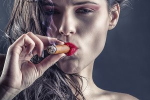 Girl smoking a cigar