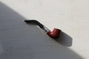 brown tobacco pipe on a white background