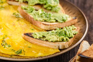 Egg omelette with garlic avocado toast
