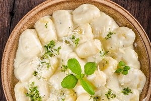 Cheese gnocchi with blue cheese sauce and galic