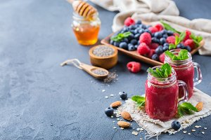 Healthy mixed smoothie for breakfast with berries, blueberry, raspberry