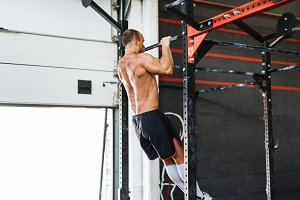 Young bodybuilder doing pull-up