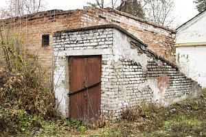 Old abandoned cellar with a red door