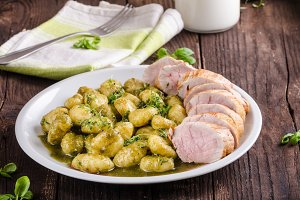 Pork tenderloin with herbs and spices, pesto gnocchi