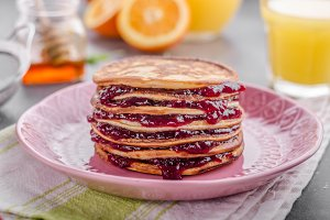 Pancakes strawberry, sugar and jam