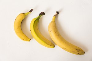 Ripe bananas on white background