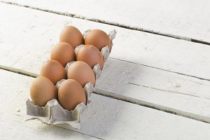 Eggs in a tray on white boards