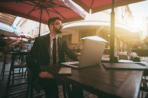 Man entrepreneur with laptop outdoor