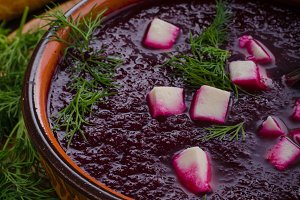 Beet soup with cheese and herbs