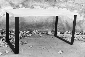 Wooden Table n a Terrace with Leaves