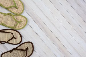 Flip Flops on Wood Background