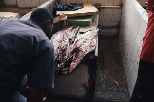 Man cutting fresh king fish market