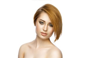 Beautiful young woman with straight short hair isolated on white