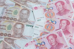 thai banknotes and yuan banknotes