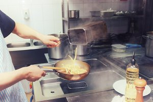 Chef is cooking pasta, toned