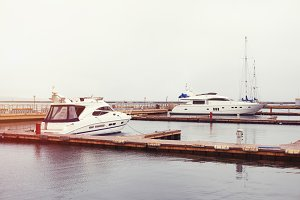 luxury yachts parked in a bay on the