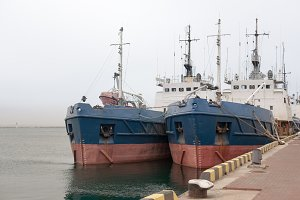 3 photo of two ship in sea port