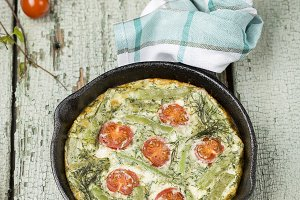 classic omelet with cherry tomatoes,