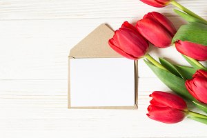 Envelope, greeting card and tulips