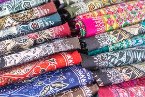 colorful printed rolls of cloth