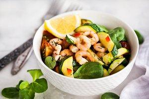 Shrimps and zucchini warm salad