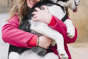 Beautiful blond woman with pet husky