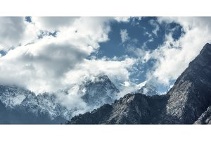 Majestical scene with mountains in clouds