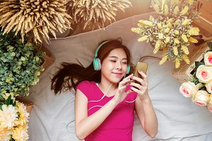 Happy Young Woman Listening Music