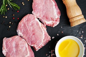 Fresh raw pork chops with spices