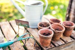 Garden tools and flower pots in the garden.