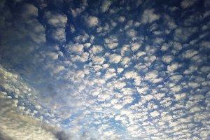 Dramatic fleecy cloudscape background