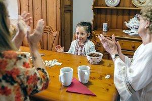 Little girl winning domino