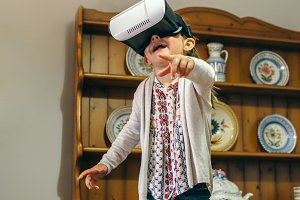 Little girl using virtual reality glasses