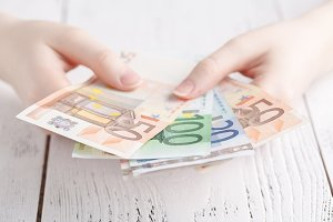 female hands holding few euro