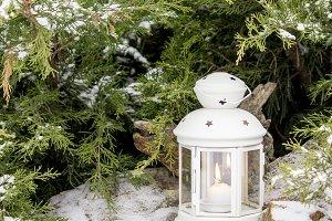 Beautiful white lantern in the snow.