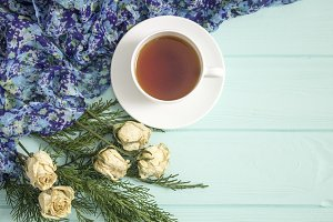 Cup of tea with dried roses