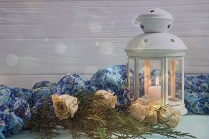 White lantern and dried roses