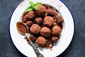 Homemade chocolate truffles on white