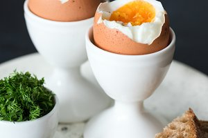 Boiled eggs with sea salt and toasts