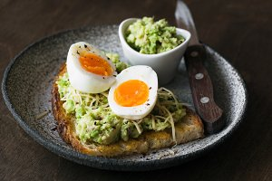 Toast with mashed avocado, egg and c