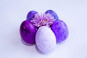Purple eggs with a flower